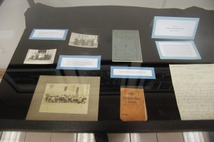 In the left case, there are items from the early days of Kingsport Public School. Photographs, a brochure, and the principal's address book.