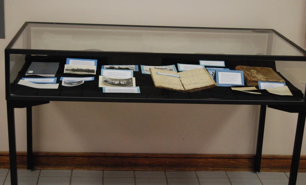 The right case's Sullivan Cuonty and Boatyard themed items range from ca. 1800-1972.