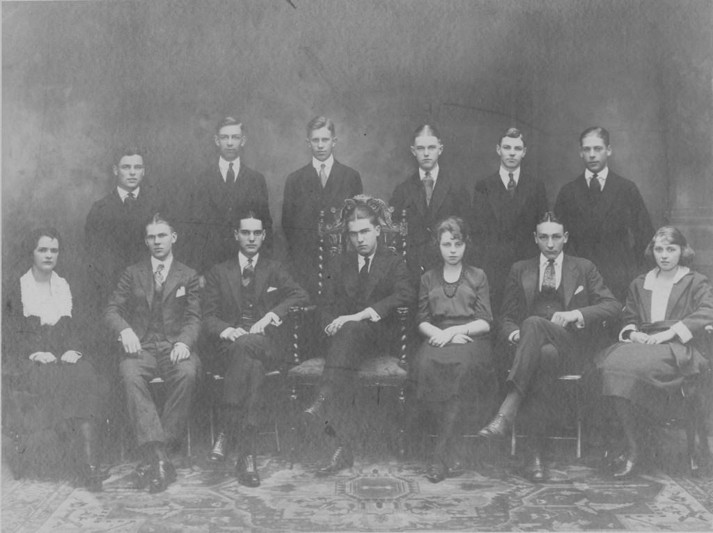 Raymond Bennett is seated in the center of this class photo.