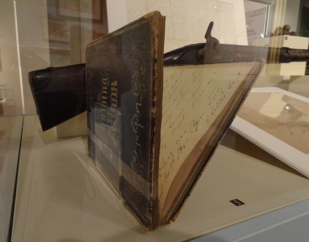This book required even more delicacy, so the curator used a plastic band to secure the open pages to the stand, itself, without any adhesive touching the book.