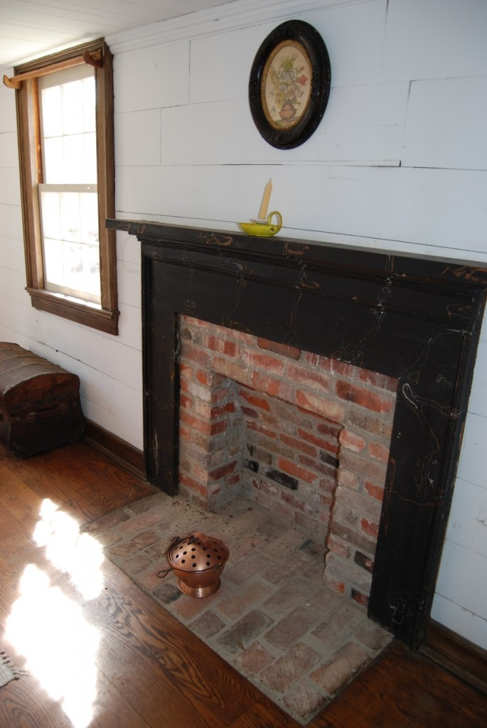 The false fireplace provided a safe place to put hot coals for heating the room.