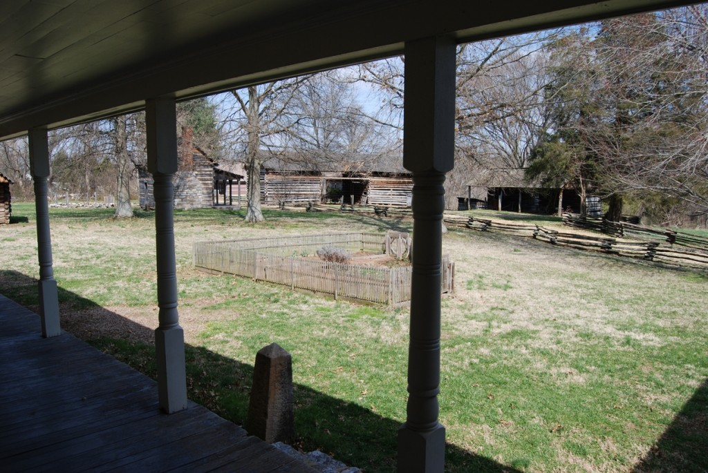 Looking out from the addition's porch, visitors can see the corn crib, barn, slave cabin, and one tiny corner of the smokehouse.