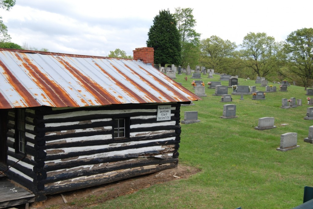 Locals will recognize the entrance to the cemetery from this rustic-looking utility cabin.