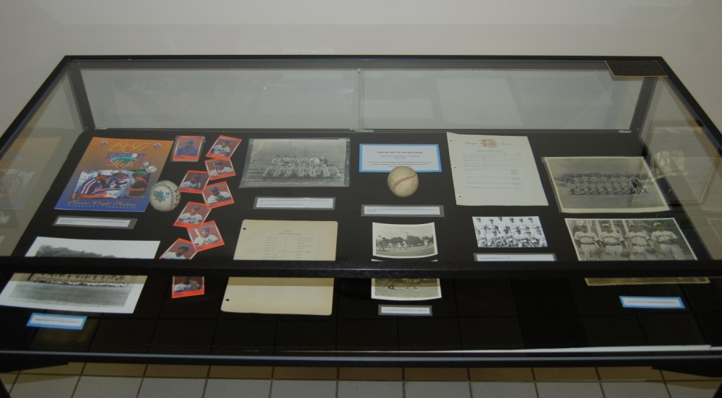 Items in the left case include memorabilia from Kingsport's minor league baseball teams, statistics from Dobyns-Bennett's 1950s seasons, and the first ball thrown in the new J. Fred Johnson Stadium.