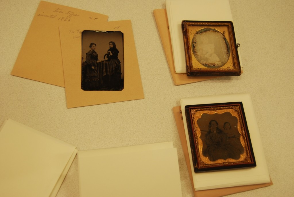 Clockwise: a tintype print, a framed daguerrotype, and a ambrotype print (1855-65).