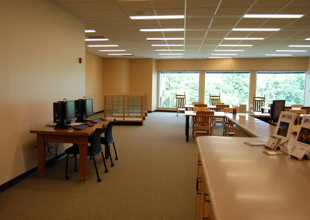 Patron computers to the left and reading tables to the right. In the background, those famous rocking chairs overlooking a beautiful view of campus and surrounding mountains.