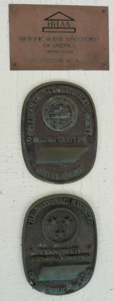 Markers designating the home as a national historic place, an historic place of Sullivan County, and as a historic house of America.