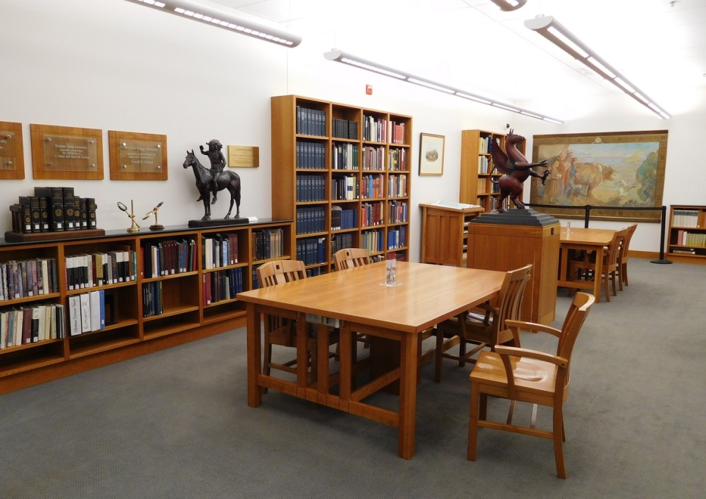 The open reading room is surrounded by reference volumes and beautiful artwork.