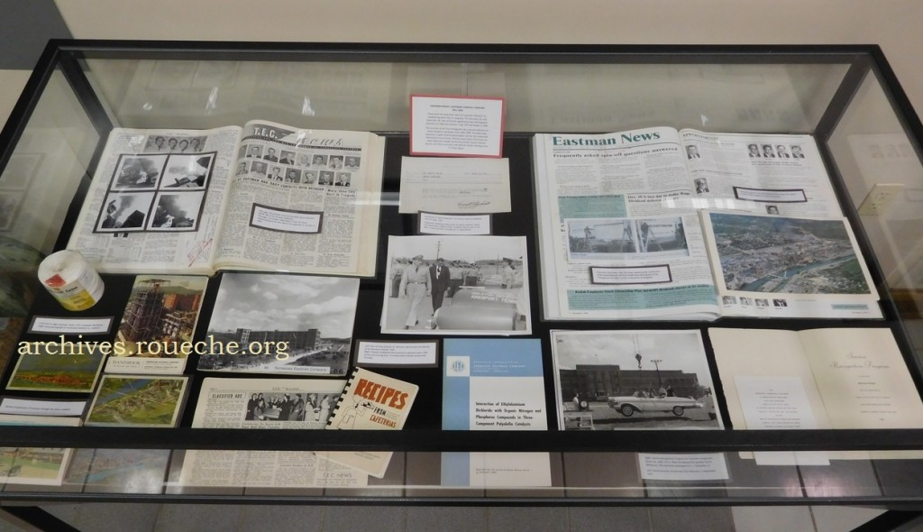 Items in the right exhibit case represent Eastman's history from 1951-1994.