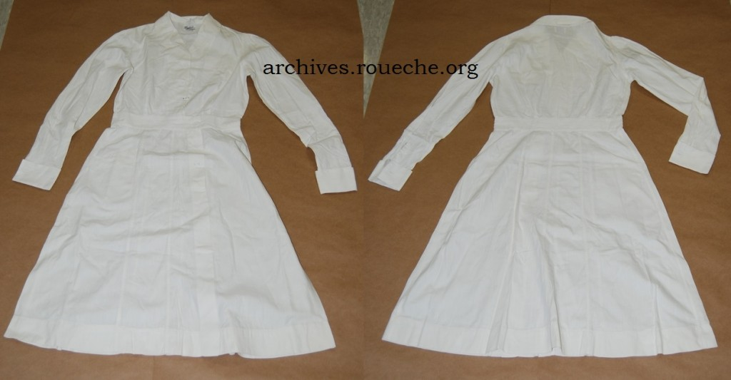 Full length white nurse's dress by Isabel Uniform Co., date unknown.