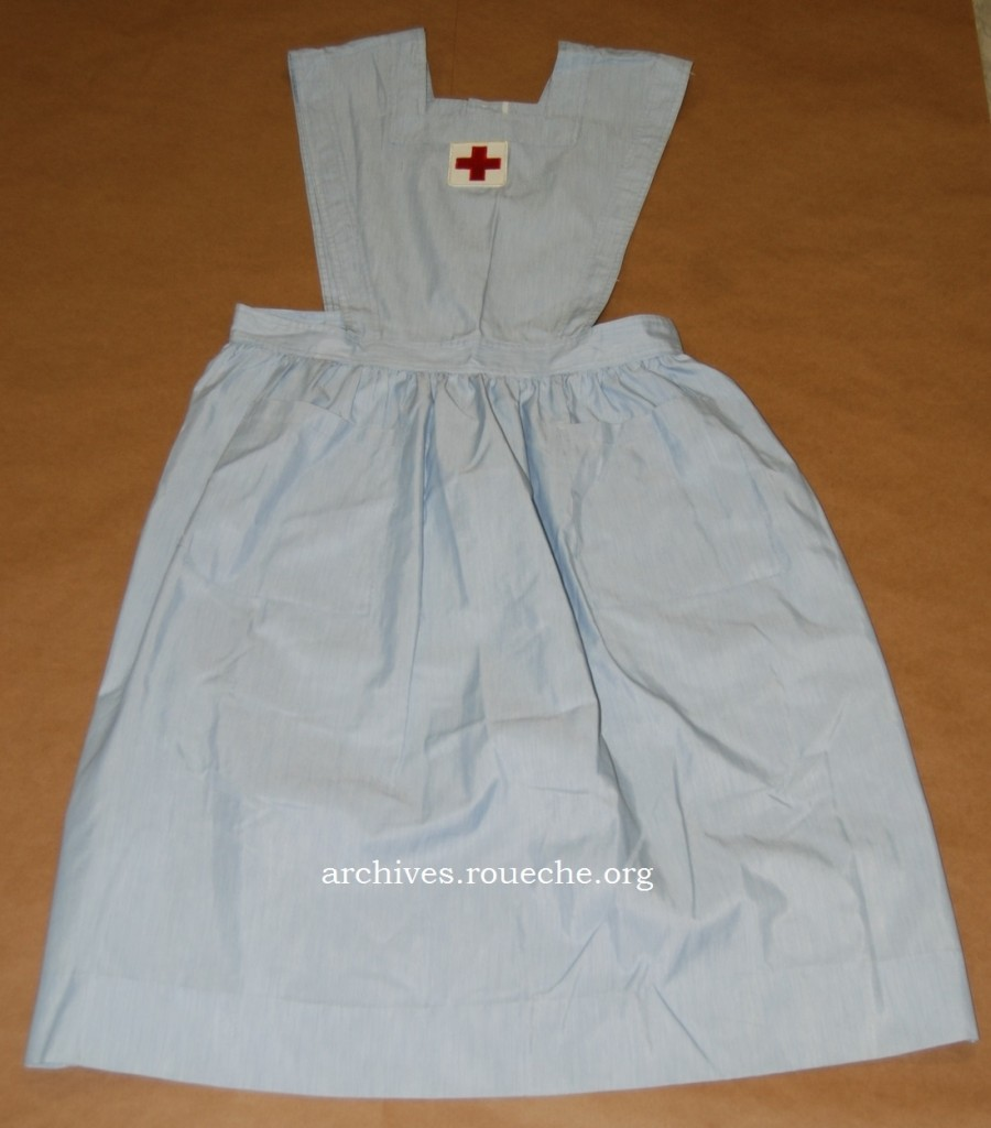 Blue striped pinafore by the Hoover Co. worn by nurse's aides; circa 1960-1970s.